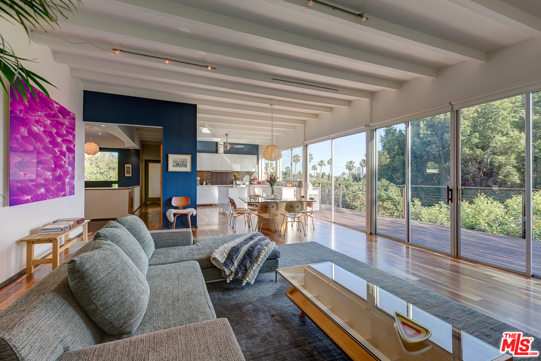 Tucked into a quiet and coveted Silver Lake enclave, this 60s mid-century modern has been remodeled and reimagined with an architect's touch