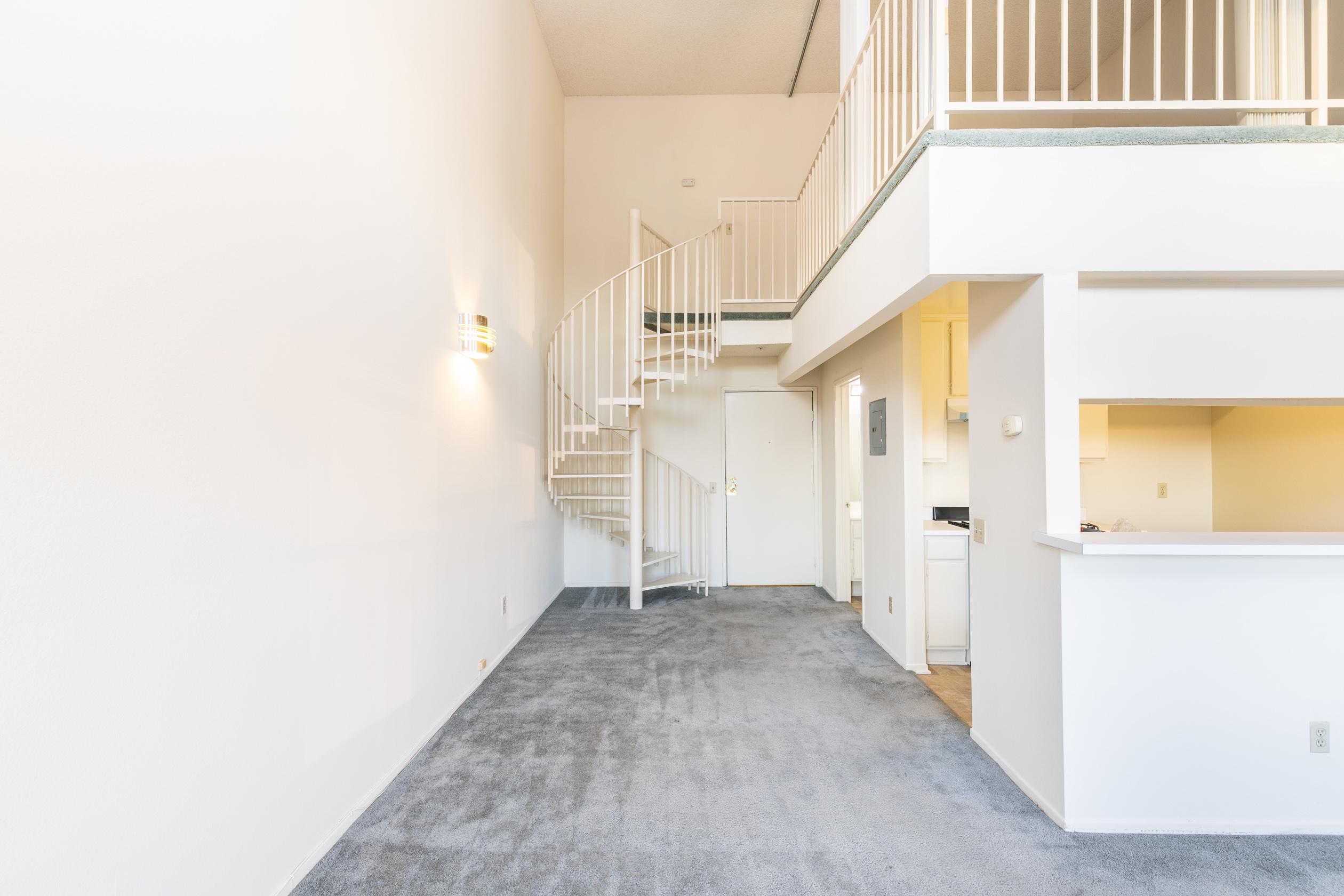 Loft Living! | Atrium Ceilings + Large Windows | 1 Parking Spot Included