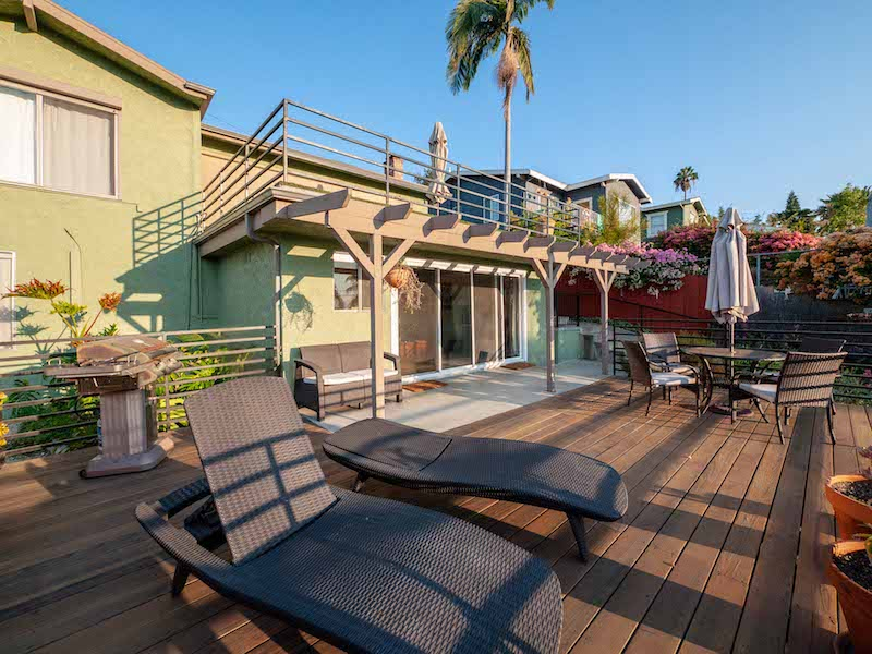 Silver Lake Treehouse with Bird's Eye Views | Huge Private Deck | Bonus Storage | In-unit Laundry & One Car Garage