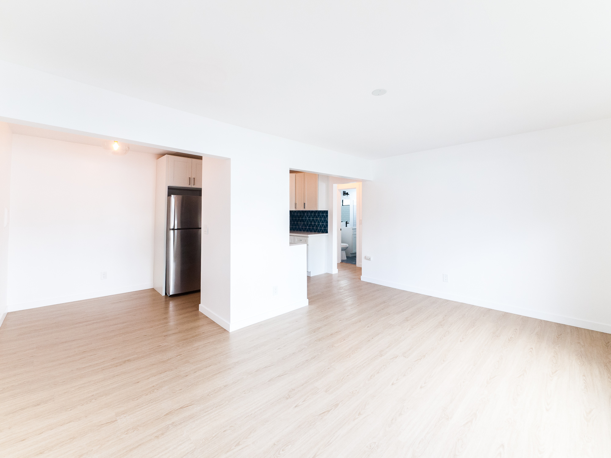 Top Floor Corner Unit with Courtyard Views | Two Blocks from Figueroa | Parking Included
