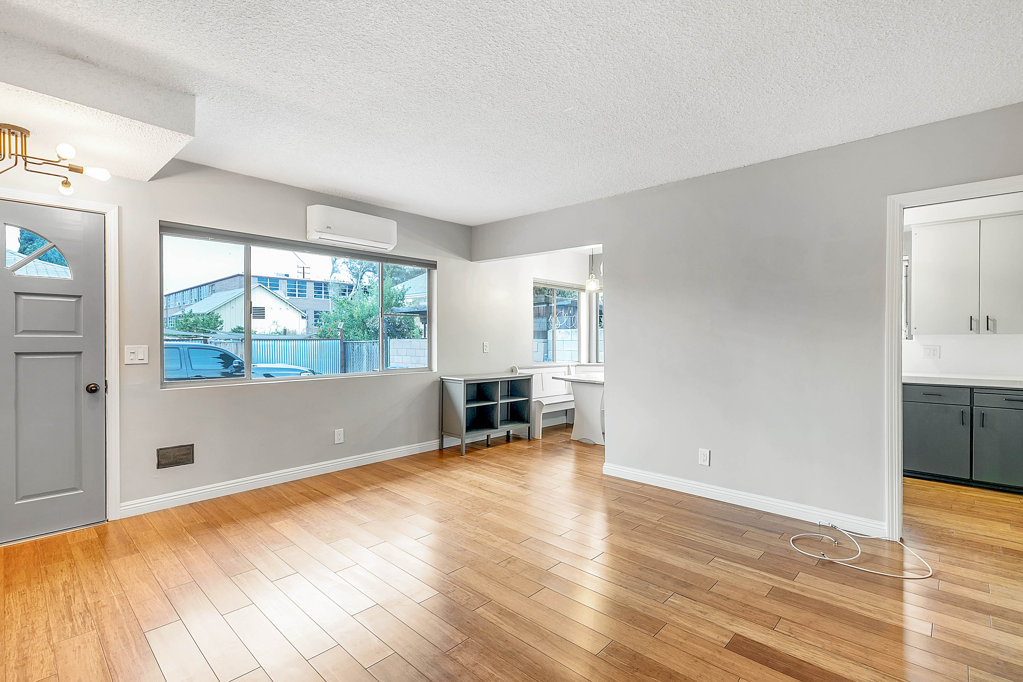 Freshly Updated Lincoln Heights Duplex | Renovated & Features New Combo W/D & Ductless AC | Spacious Shared Patio | 1 Parking Space Included!