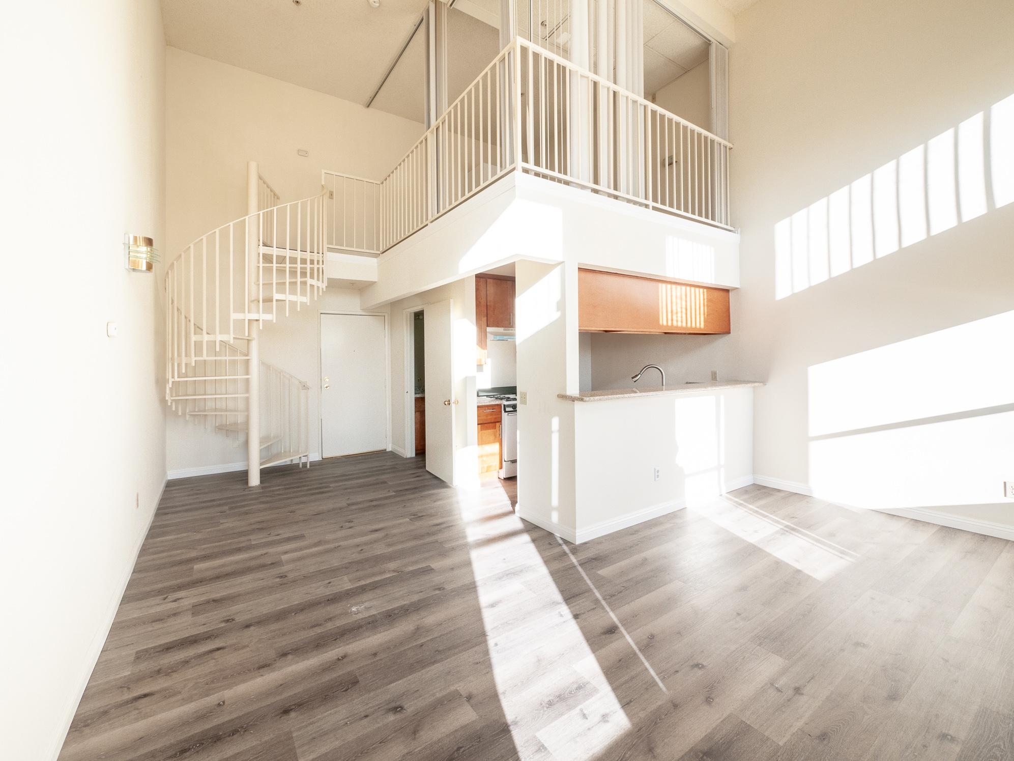 Studio/Loft- Atrium Ceilings - Double Height Windows- Central Air- 2 Parking Spots!