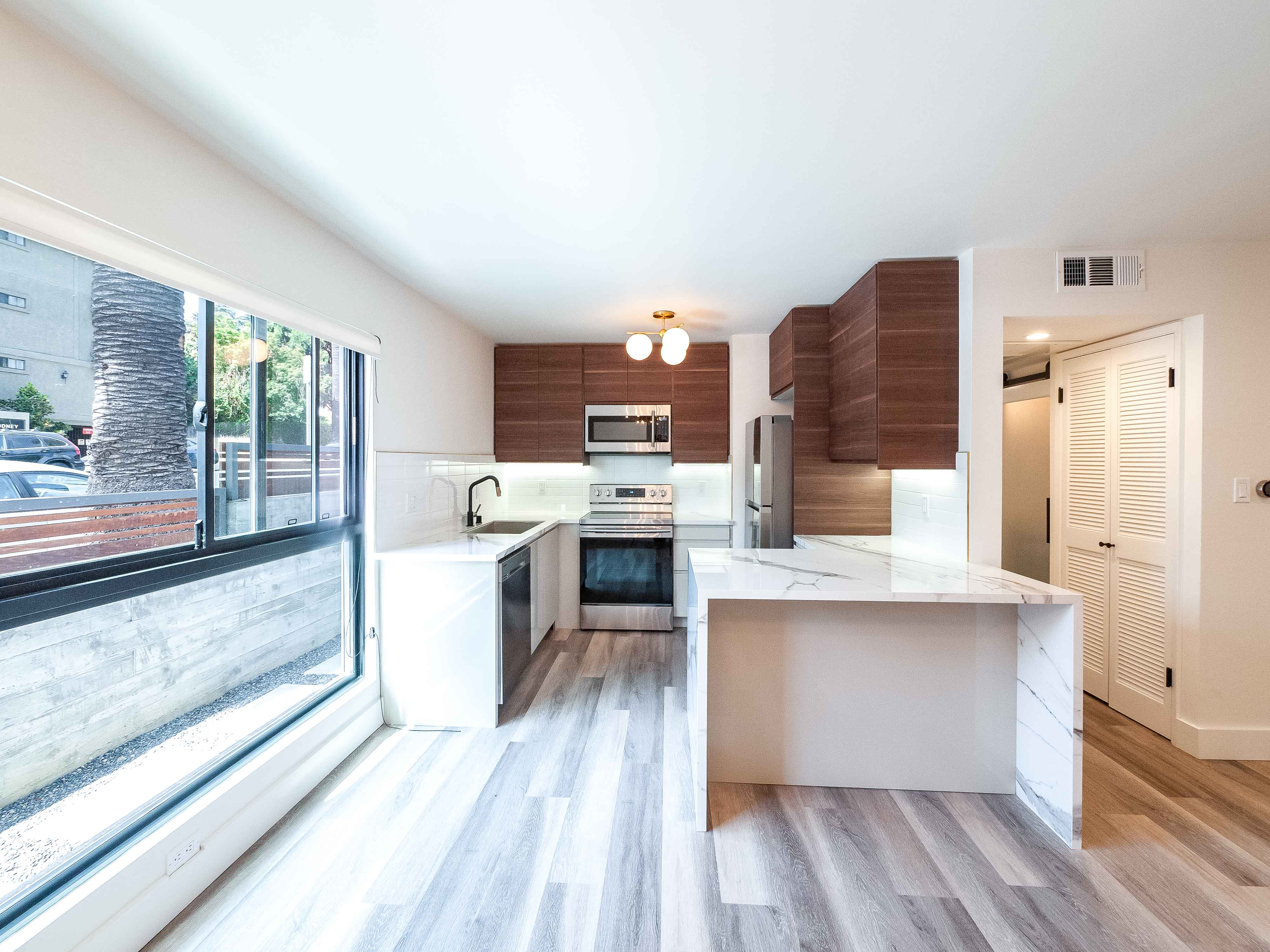 Luxurious Designer Pad | 400 Sq Ft Private Patio | High-End Upgrades| Parking + Laundry in unit | Walker's Paradise!
