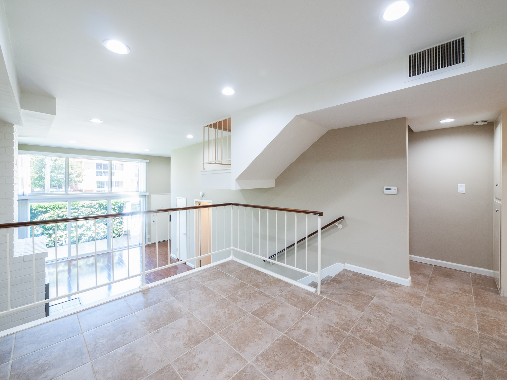 Dramatic High Ceilings & Floor-to-Ceiling Windows in This Exceptionally Remodeled Tri-Level Townhouse with Attached 2-Car Garage