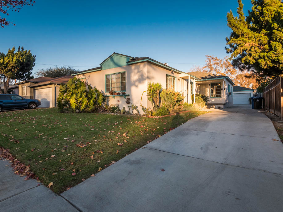 Mid Century duplex with detached garage and extra large back yard