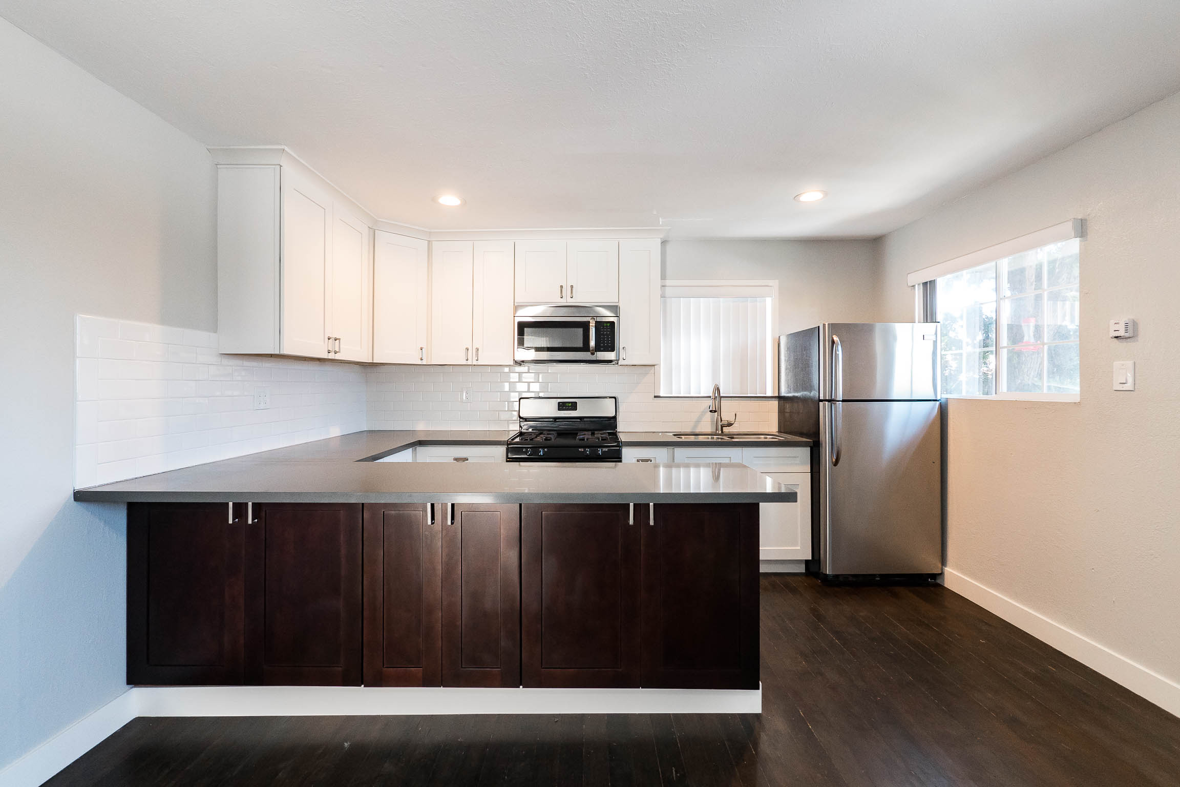 Beautifully Renovated 2 bed/1Bath Home -Sleek Finishes - Huge Kitchen-Private Outdoor Space- Convenient Location