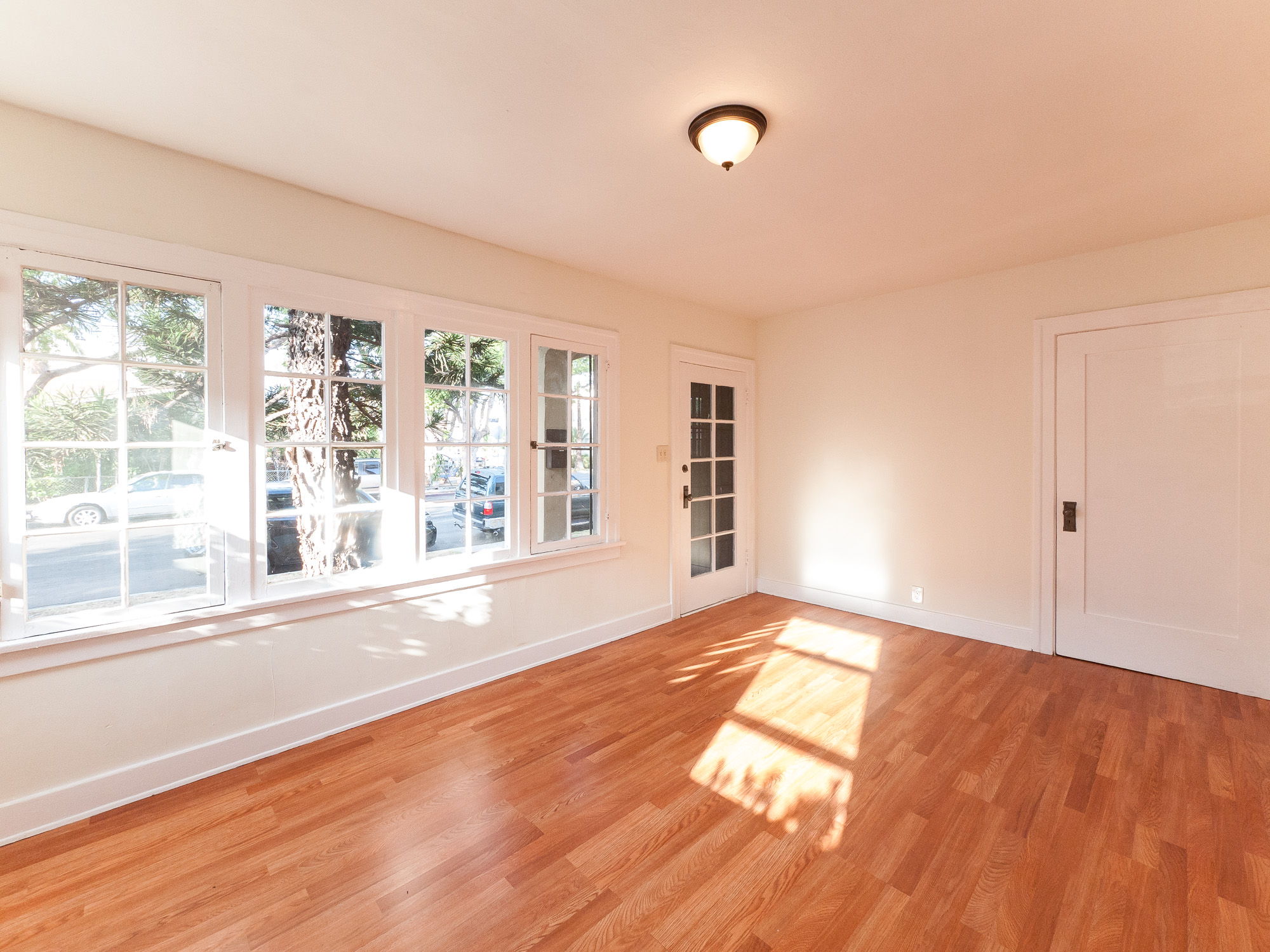 Charming First Floor 1 Bedroom with TONS of WINDOWS & NEW KITCHEN! Parking included!