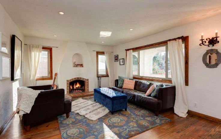 This lovely 2 bedroom + 1 bathroom Spanish style home is nestled in the foothills of Highland Park
