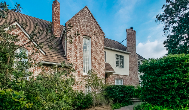 LEASED! Sense the historic grandeur in this Country English Tudor Estate.