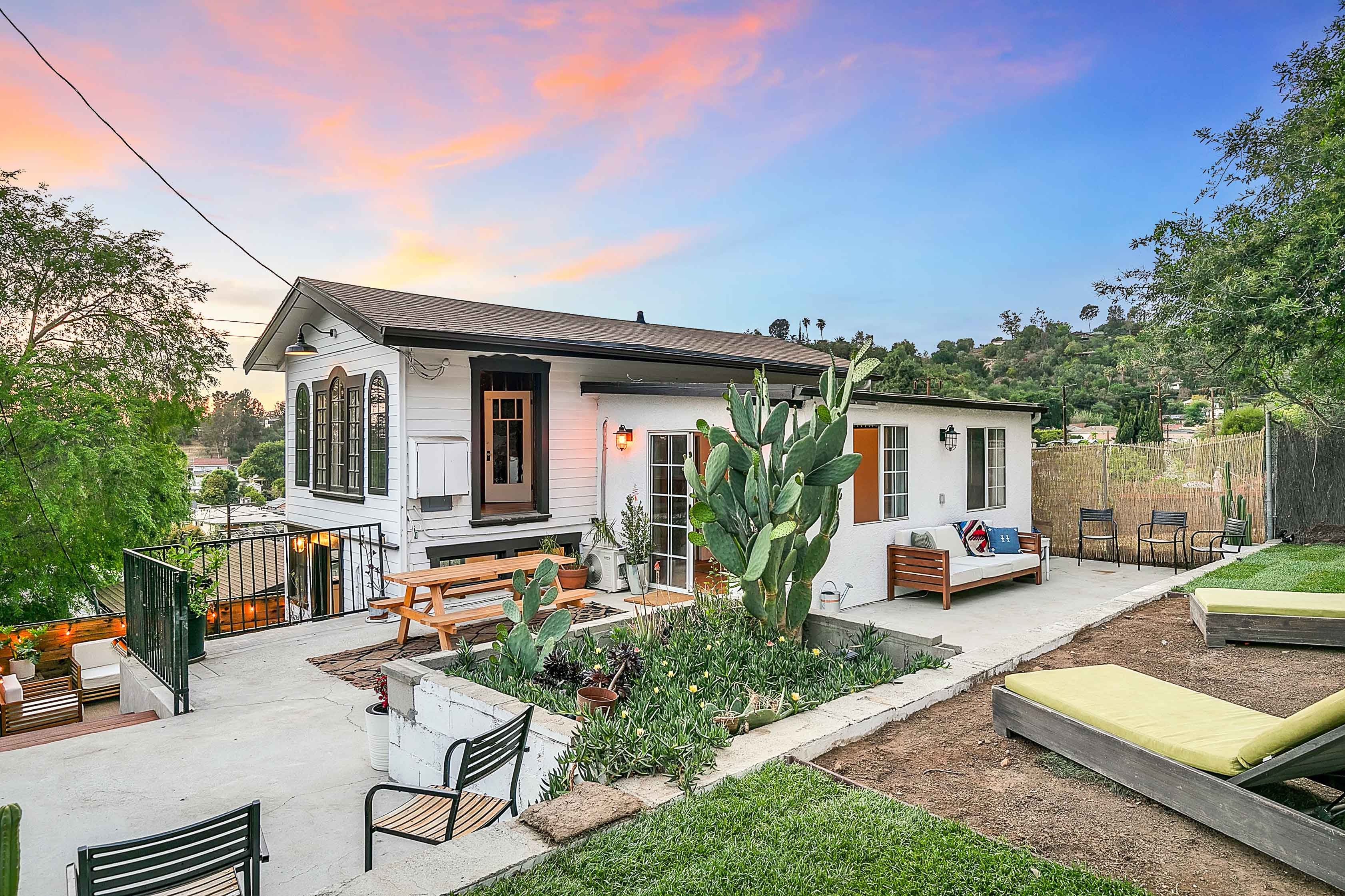 NELA Cottage Gem | Phenomenal Outdoor Spaces + Spanish-Style Fireplace | Stunning Updates Throughout | Ductless A/C On Each Floor