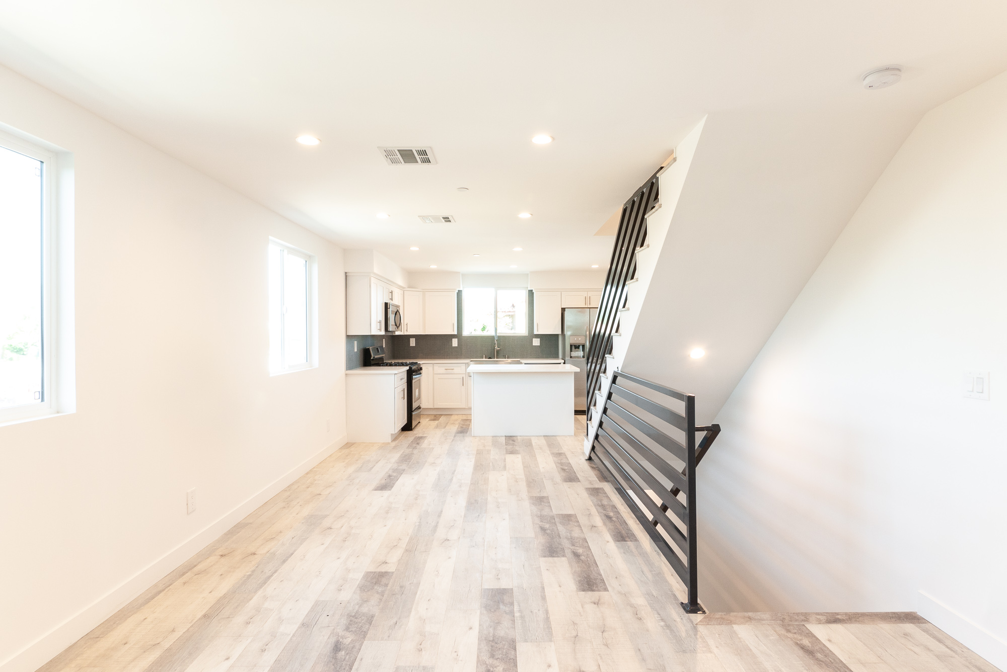 Brand New Build Done Right! Stunning 2 Story Townhouse - Central Air  & Heat - Open Kitchen with Farmhouse Sink - 2 Car Parking Garage- Central Location!