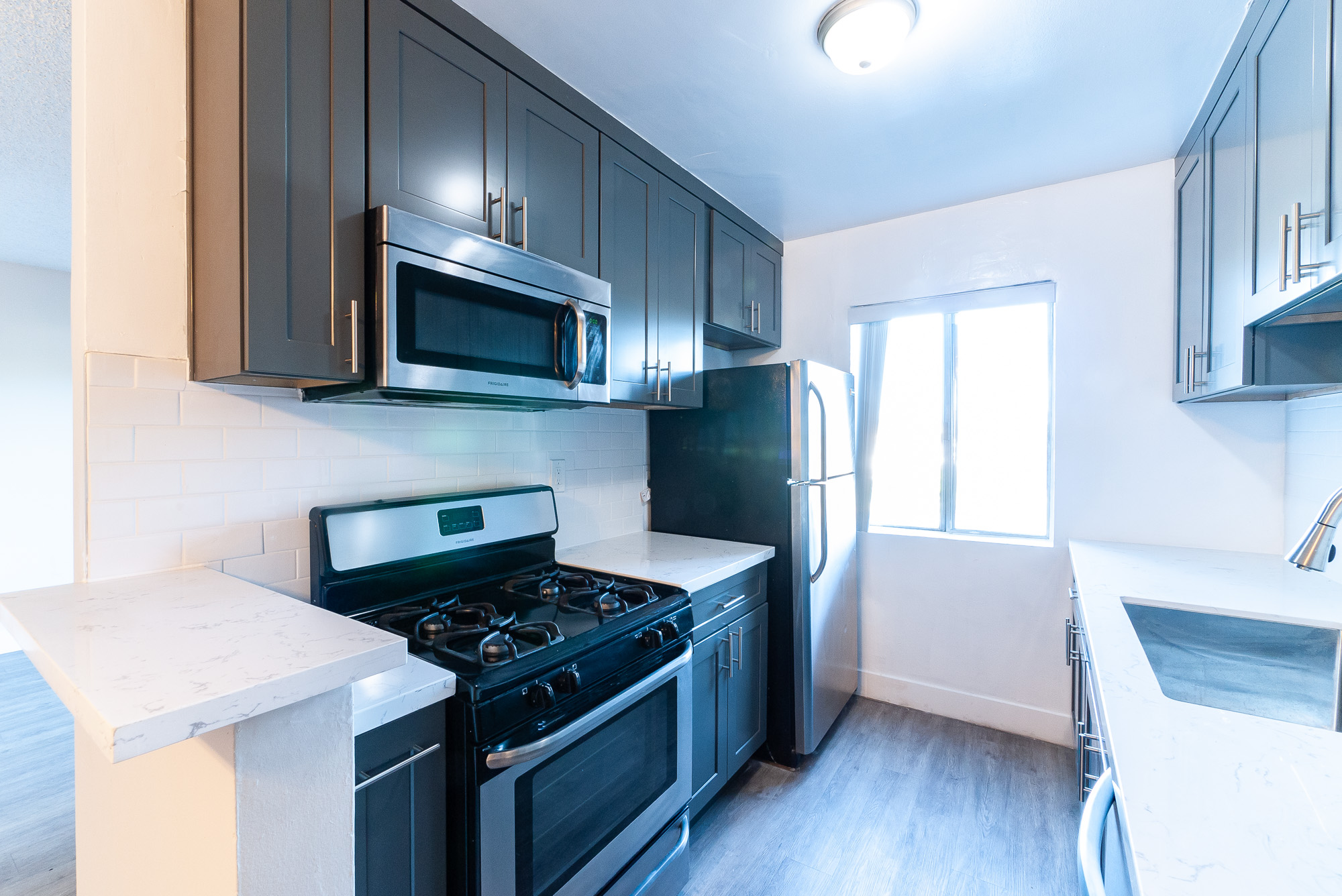 IT'S A MOD WORLD! BRAND NEW RENOVATION! MID - CENTURY 2 BD / 1.5 BA -STAINLESS APPLIANCES - PARKING