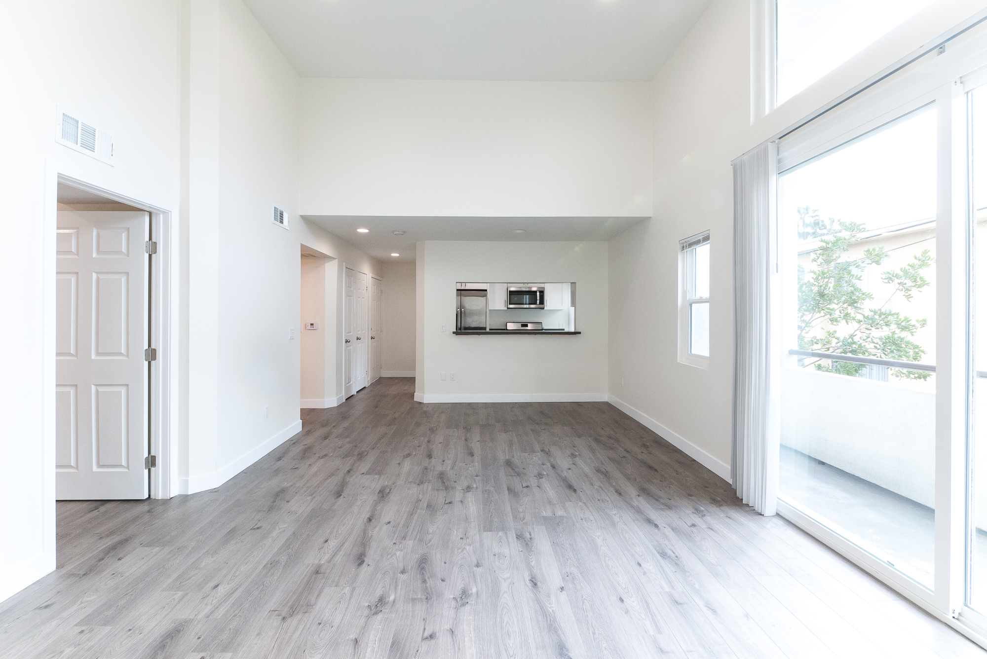 BEYOND GORGEOUS 2BR/2BR with 12 FT Ceilings and TWO BALCONIES! Parking, too!